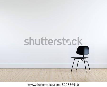 Modern black chair in white room interior parquet wood floor.