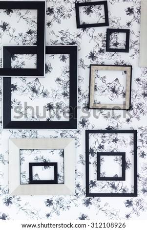 Modern black frame on black flower background.