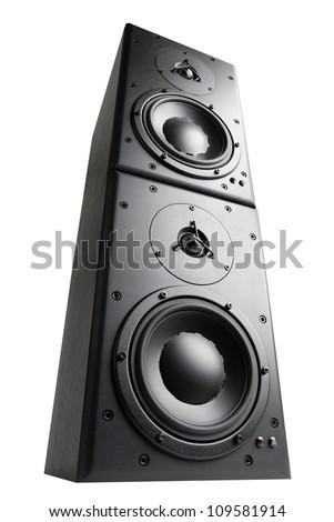 Modern black loudspeakers towering on top of each other, isolated studio shot