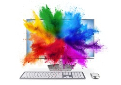 modern black silver pc monitor with mouse and keyboard colorful rainbow holi powder cloud explosion through screen isolated on white background. computer multimedia abstract art streaming concept.