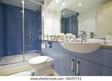modern blue bathroom with shower cabin