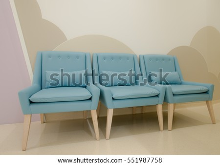 Modern blue chairs standing in interior empty room for copy space. minimal space. Blue chairs in living room space . minimal concept #551987758