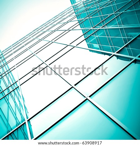 modern blue glass skyscraper perspective view