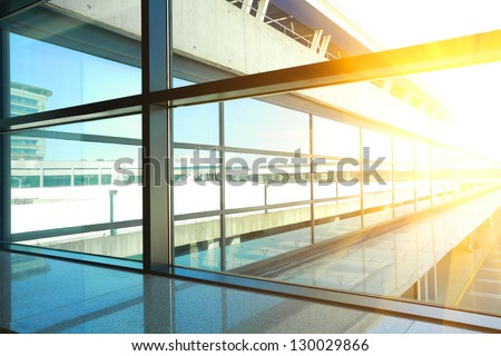 modern blue glass wall of office building #130029866