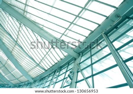 modern blue glass wall of office buildings