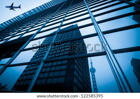 modern blue glass wall of skyscraper