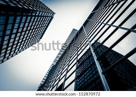 modern blue glass wall of skyscraper