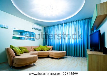 Modern blue room interior with TV and sofa