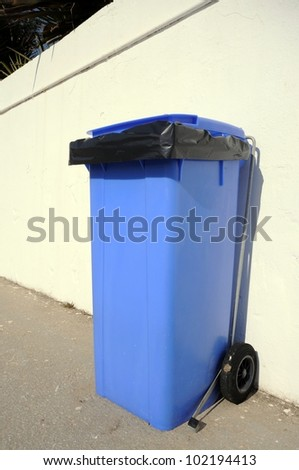 Modern blue rubbish bin, Puerto Cabopino, Costa del Sol, Malaga Province, Andalusia, Spain, Western Europe. - stock photo