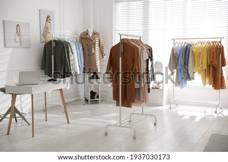 Modern boutique interior with stylish clothes and laptop Сток-фото ©