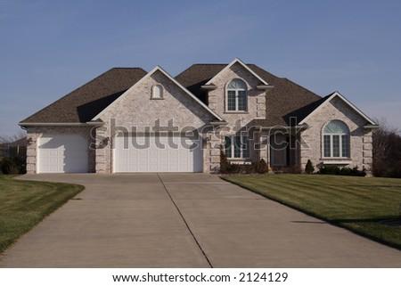 Modern brick home with atrium windows large garage porch for Where to buy atrium windows
