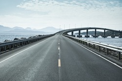 Modern bridge over islands in Norway.