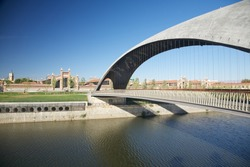 modern bridge over Manzanares river in Madrid city Spain