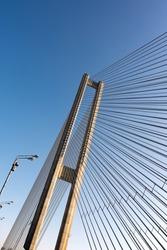 Modern bridge steel ropes constructions on sky  background