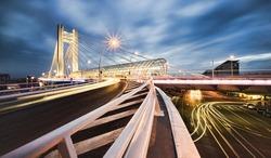 modern bridge with night traffic, Bucharest city, Romania