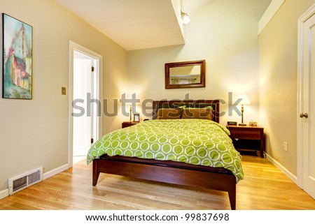 Modern Bright Green And Beige Bedroom With Brown Bed