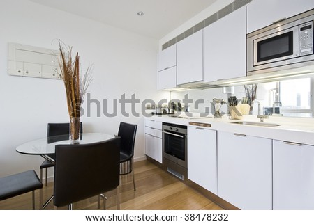 modern bright kitchen with dining table for four