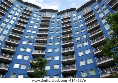 Modern British apartment / block of flats - blue, curved architecture