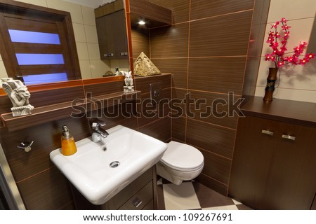 Modern brown bathroom interior - stock photo