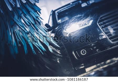 Modern Brush Car Wash Blue Color Graded Concept.