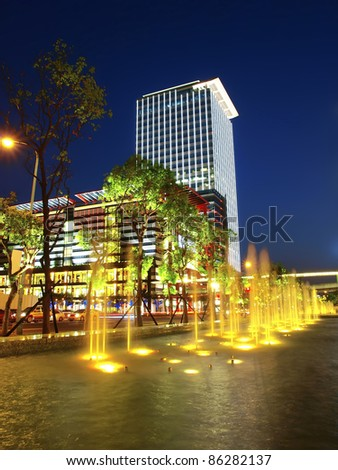 Modern building and  fountain in night