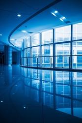 modern building corridoe with glass windows,blue toned,china.