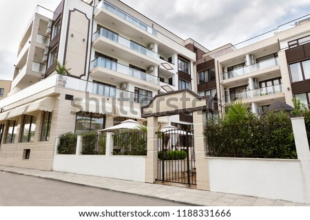 Modern Building Exterior. Facade of a Modern Apartment Building. Vacation Complex Hotel Building, With Stone Tiling Facade.