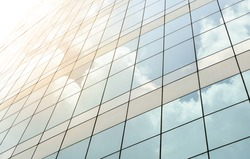 Modern building glass windows with sky reflection
