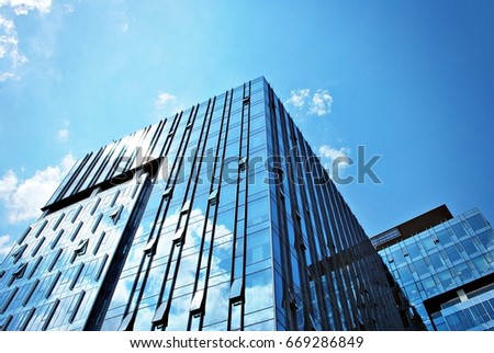 Modern building.Modern office building with facade of glass #669286849
