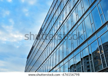 Modern building.Modern office building with facade of glass - Shutterstock ID 676156798