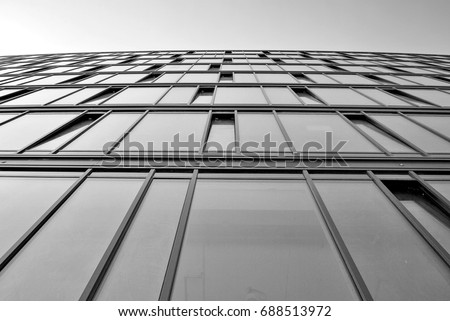 Modern building.Modern office building with facade of glass. Black and white. #688513972