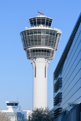 Modern building of air traffic control local tower in Munich international passenger and cargo hub airport