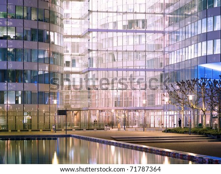 Modern building office  architecture at night - stock photo