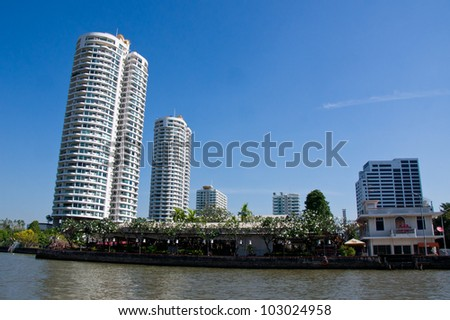 Modern building on the Riverside of Chaopraya river , Bangkok Thailand