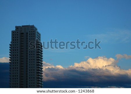 Modern building silhouette with a blue sky