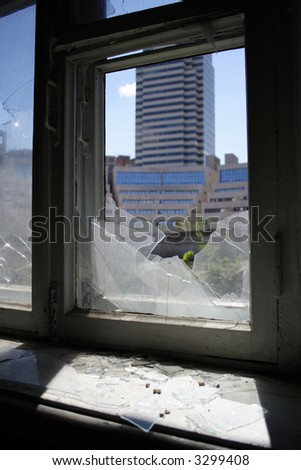 modern building through the demolished house window