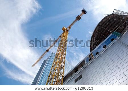 Modern building under construction against blue sky #61288813
