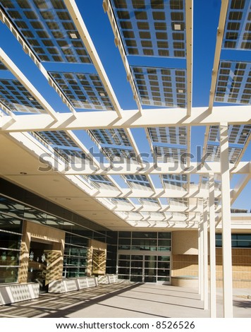 Modern building utilizing solar energy cells incoropated into the architecture