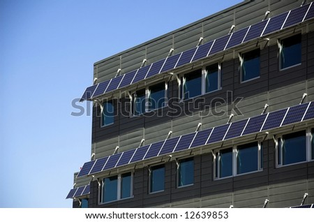 modern building utilizing the environmental technology. The Solar panels do double duty and provide energy for electricity and shade over the windows to lower ambient temperature within the building.