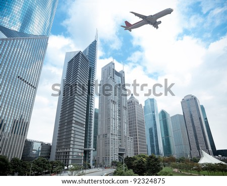 modern building with airplane under the sky in shanghai