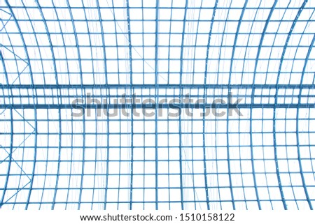 Modern building with glass curving roof. Fragment of ceiling or roof modular supporting structure. Steel and glass contemporary architecture. Structural glazing. Abstract architectural composition