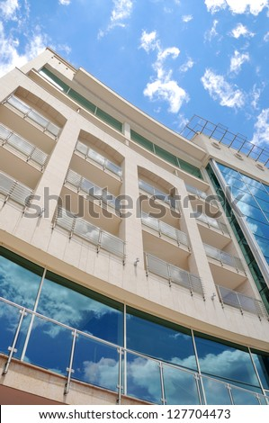 Modern building with reflection of sky on it
