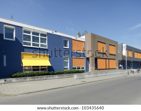 modern building with yellow and orange sunshades on a hot day