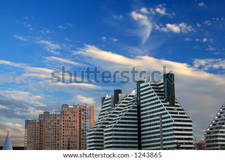 modern buildings and a nice blue sky with clouds