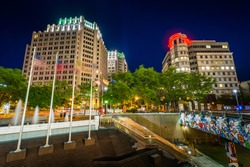 Modern buildings and metro station at night, in downtown Bethesda, Maryland.