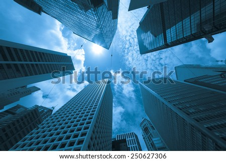 Modern buildings in downtown district of Hong Kong, blue tone #250627306