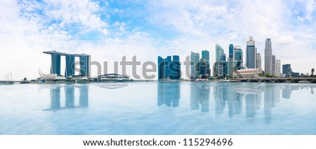 Modern buildings of Singapore skyline landscape in business district  with blue sky and reflection in water of Marina Bay #115294696