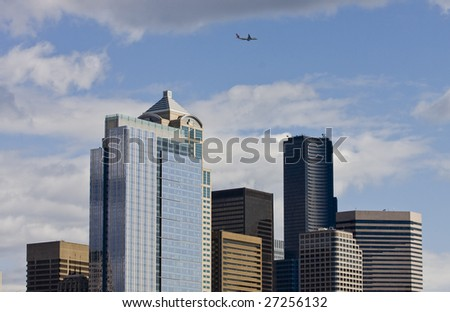 Modern Buildings of the Seattle Skyline with a airplane flying over