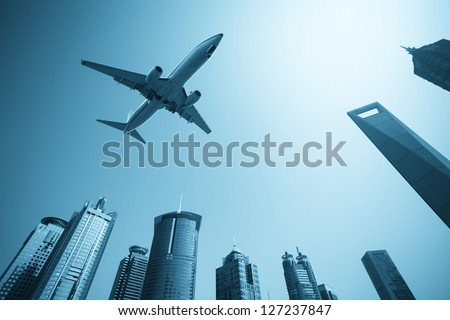modern buildings skyline with airplane in shanghai financial center