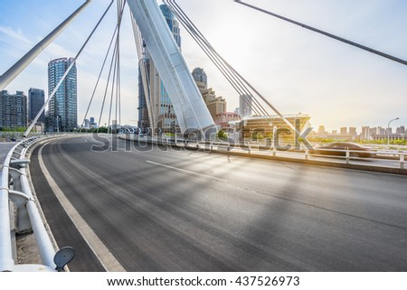 modern buildings with empty road under blue sky,tianjin china. #437526973